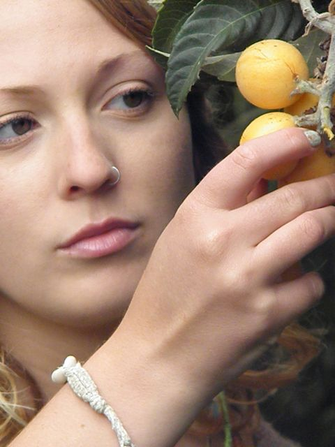 http://curezone.com/upload/Blogs/Your_Enchanted_Gardener/Abagail_Reed_with_Loquat_Tree.jpg