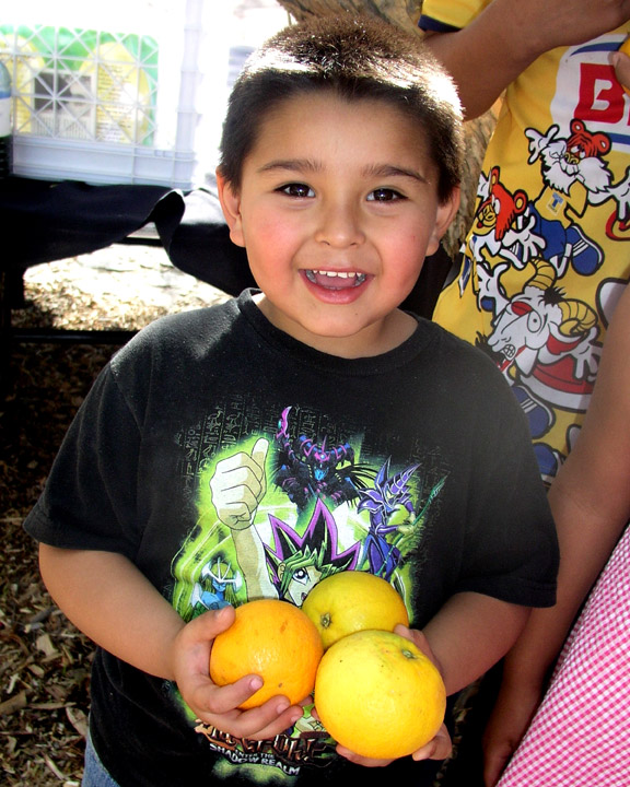 http://curezone.com/upload/Blogs/Your_Enchanted_Gardener/Child_gets_oranges_WEB.jpg