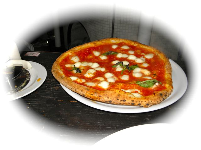 http://curezone.com/upload/Blogs/Your_Enchanted_Gardener/Yummy_Pizza_from_Caffe_Calabria.jpg