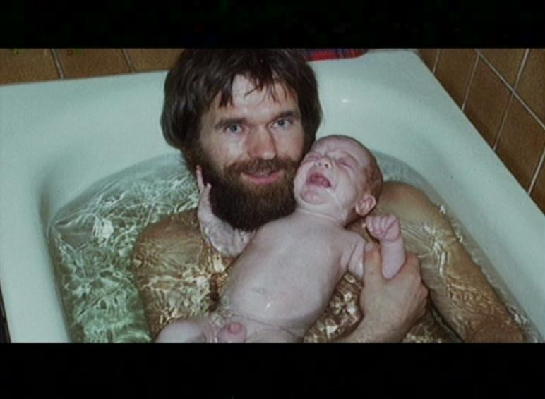 father and son taking a bath ... (Click to enlarge)